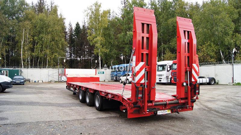 neuer GRUNWALD Triaxial low bed semitrailer Tieflader Auflieger