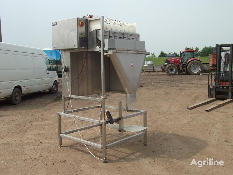 NEWTEC (vesovaya stanciya - 8-mi chashechnaya) Verpackungsmaschine